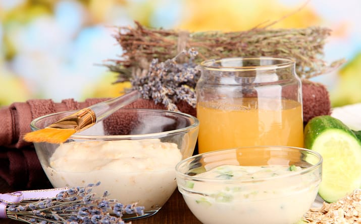 Homemade facial masks with natural ingredients, on color wooden